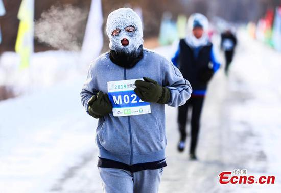 Snowy marathon held in China's 'pole of cold'