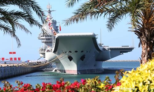 Aircraft carrier Shandong berths at a naval port in Sanya. (Photo/China Military)