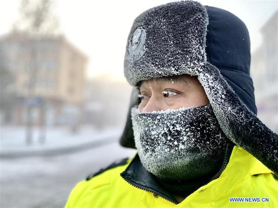 Mohe traffic police officers work outdoors in extremely cold weather