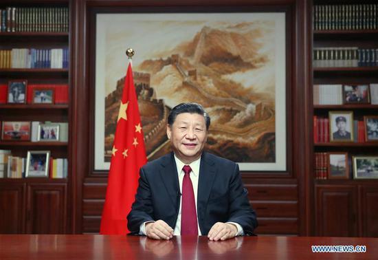 水果机国家主席习近平周二晚在北京发表新年演讲,以期在2020年敲响。(新华社/鞠鹏)