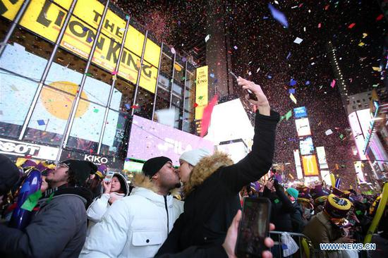 Kisses, cheers and fireworks welcome 2020 in Times Square
