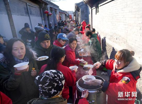Laba porridge sweetens prelude of Chinese Lunar New Year