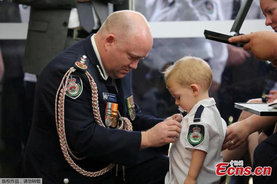 Toddler son receives posthumous medal for killed Australian firefighter