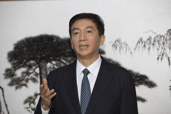 New director of liaison office says confident of Hong Kong's long-term prosperity, stability
