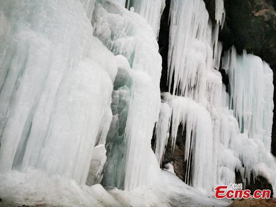 Scenery of frozen waterfall in China's Qilian Mountain