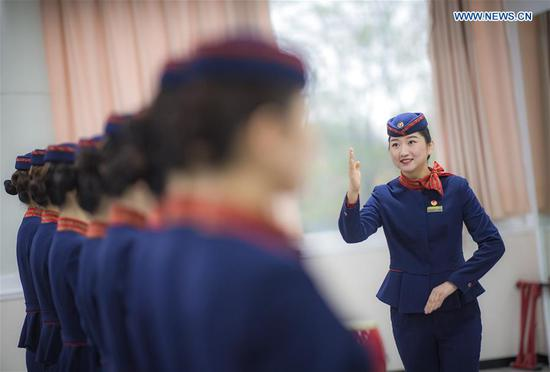 Stewardesses take part in training for Spring Festival travel rush in Wuhan