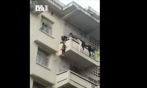 Grandmother dangles grandson from balcony to save her cat