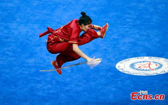 Thuy from Vietnam competes in the 15th World Wushu Championships (WWC), hosted by the International Wushu Federation, in Shanghai, Oct. 20, 2019. (Photo: China News Service/Tang Yanjun)
