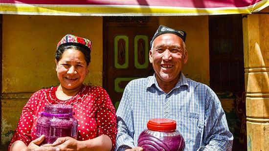 Xinhua's file photo of flower grower Ruz and his wife Tajinisa who show their handmade rose sauces at a village in Hotan, Northwest China's Xinjiang Uygur autonomous region.