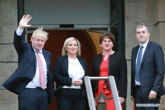 British Prime Minister Boris Johnson (1st L) and British Secretary of State for Northern Ireland Julian Smith (1st R) are greeted by Northern Ireland First Minister Arlene Foster (2nd R) of the Democratic Unionist Party (DUP) and Deputy First Minister Michelle O'Neill of Sinn Fein in Belfast, Northern Ireland, the United Kingdom, on Jan. 13, 2020.  (Photo/Xinhua)
