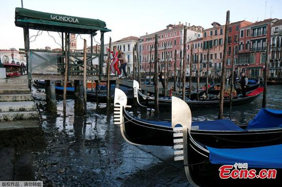 Low tide leaves Venice's canals dry, just months after severe floods