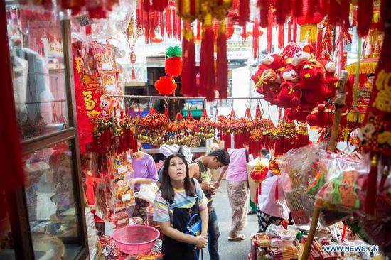 People purchase decorations for upcoming Chinese Lunar New Year in Yangon, Myanmar