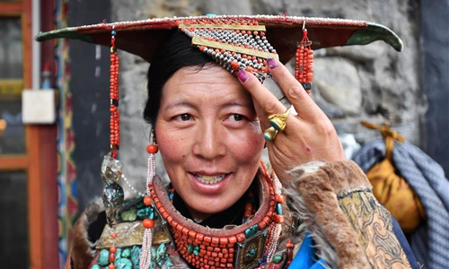 A woman wears Burang clothes in Burang county of Ali, Southwest China's Tibet Autonomous Region, July 22, 2019. Burang clothes has a history of more than 1,000 years. It is decorated with gold, silver, pearls and other jewels. (Photo/Xinhua)