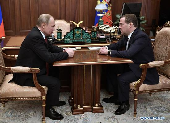 Russian President Vladimir Putin (L) meets with Russian Prime Minister Dmitry Medvedev in Moscow, Russia, Jan. 15, 2020. The Russian government resigned Wednesday, Russian news agencies reported, quoting Prime Minister Dmitry Medvedev. The decision was announced after President Vladimir Putin addressed the Federal Assembly. (RIA Novosti via Xinhua)