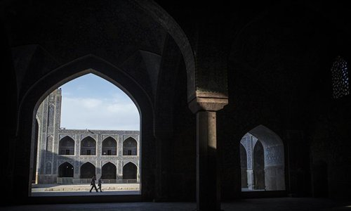 People walk at a mosque in Naghshe Jahan Square in Isfahan, Iran, on July 17, 2019. Constructed between 1598 and 1629, Isfahan is now an important historical site, and one of UNESCO's World Heritage Sites. (Photo/Xinhua/Ahmad Halabisaz)