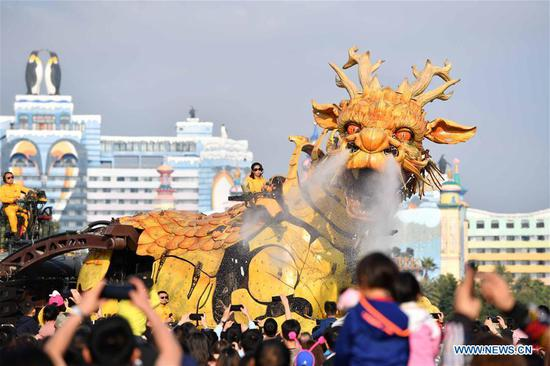 People watch mechanical Horse Dragon Long Ma in Zhuhai, S China