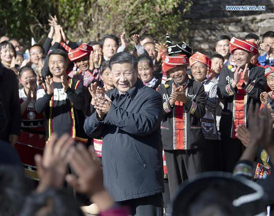 General Secretary of the Communist Party of China (CPC) Central Committee Xi Jinping, also Chinese president and chairman of the Central Military Commission, extends Chinese New Year greetings to the villagers in a village of the Wa ethnic group in Qingshui Township of Tengchong, southwest China's Yunnan Province, Jan. 19, 2020. Xi visited Simola Wa Village, Tengchong City, during an inspection tour to Yunnan ahead of the Chinese New Year. (Xinhua/Yan Yan)