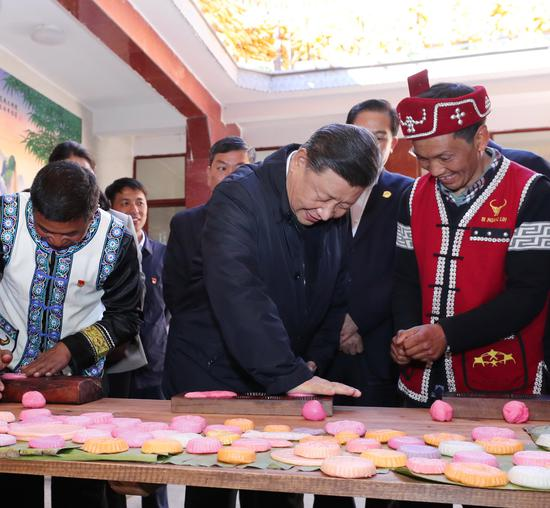 Chinese President Xi Jinping, also general secretary of the Communist Party of China Central Committee and chairman of the Central Military Commission, visits a village of the Wa ethnic group to learn about poverty alleviation efforts and extend his Chinese New Year's greetings to the villagers in Qingshui Township of the city of Tengchong, southwest China's Yunnan Province, Jan. 19, 2020. Xi visited Yunnan Province Sunday on an inspection tour ahead of Chinese New Year. (Xinhua/Ju Peng)