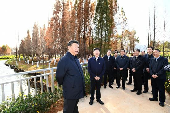 President Xi Jinping, also general secretary of the Communist Party of China (CPC) Central Committee and chairman of the Central Military Commission (CMC), visits an ecological wetland of Dianchi Lake in Kunming, capital of southwest China's Yunnan Province, Jan. 20, 2020. (Xinhua/Xie Huanchi)