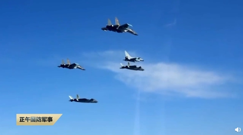 "The ""three musketeers of the sky"" – the J-20, J-16 and J-10C – fly in formation in a real-combat scenario training session. (Photo/Screenshot from China Central Television)"