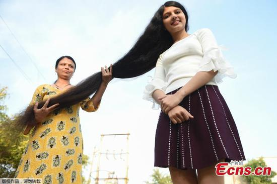 The longest hair: Indian girl sets new Guinness record