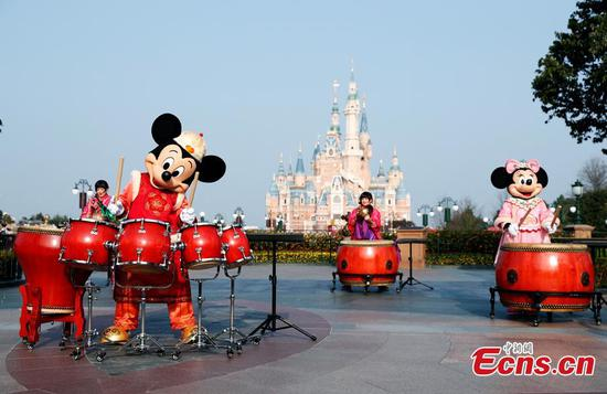 Mickey and Minnie play drums to greet the upcoming