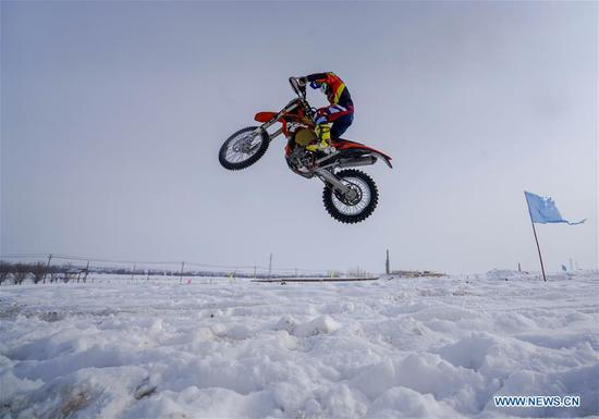 People have fun at ski resort in Tacheng, Xinjiang