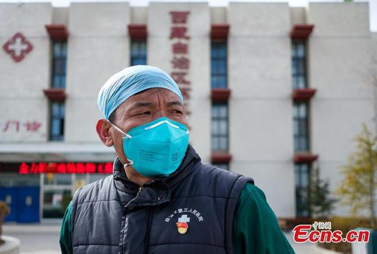 Doctors battle against novel coronavirus in designated hospital in Tibet