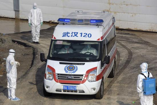 An ambulance transfers the first batch of patients infected with the novel coronavirus to Huoshenshan (Fire God Mountain) Hospital in Wuhan, central China's Hubei Province, Feb. 4, 2020. (Photo by Fan Xianhai/Xinhua)