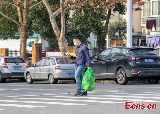 Life goes on in lockdown city of Wuhan