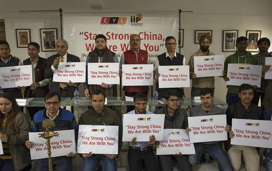 Participants hold placards during a special prayer meeting held for China in Noida, on the outskirts of New Delhi, India, Feb. 10, 2020. A special prayer meeting was held for China on Monday in Noida. The participants, mostly young students, came to express their solidarity with Chinese people -- especially the doctors and paramedical staff who are on the forefront working with dedication. (Xinhua/Javed Dar)