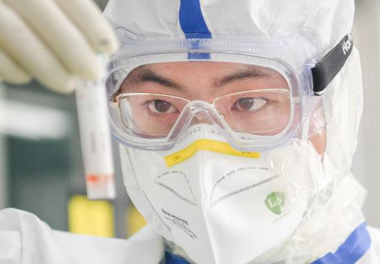 A staff member works in a laboratory in Wuhan, central China's Hubei Province, Feb. 13, 2020. (Xinhua/Cheng Min)