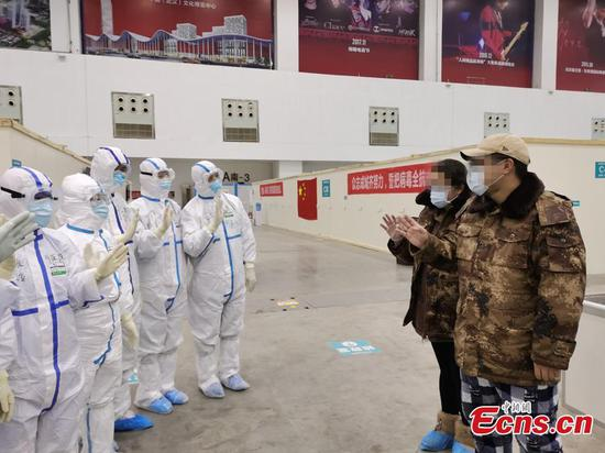1st batch of cured patients discharged from Wuhan cabin hospital