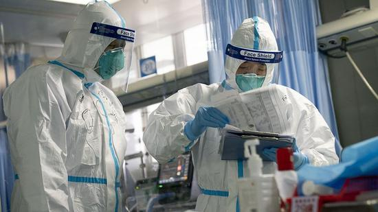 Medical workers in Zhongnan Hospital of Wuhan University in Wuhan, Central China's Hubei province, Jan 24, 2020.(Photo/Xinhua)