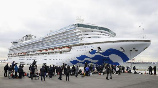 1st group of passengers start disembarking virus-hit cruise ship in Japan