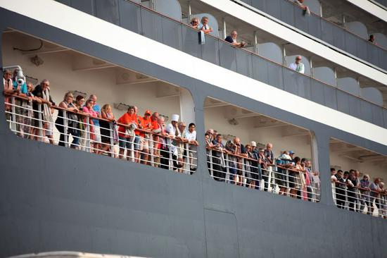 Last batch of 233 Westerdam passengers allowed to disembark in Cambodia after testing negative for COVID-19