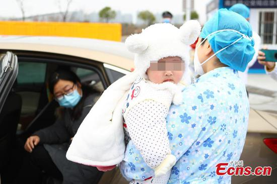 7-month-old baby infected with novel coronavirus discharged from hospital in Jiangxi