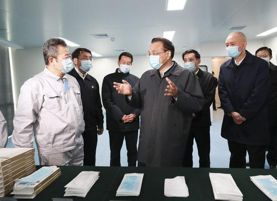 Chinese Premier Li Keqiang, also a member of the Standing Committee of the Political Bureau of the Communist Party of China (CPC) Central Committee and head of the leading group of the CPC Central Committee on the prevention and control of the novel coronavirus outbreak, inspects a medical supplies company in Haidian District of Beijing, capital of China, Feb. 21, 2020. (Xinhua/Ding Lin)