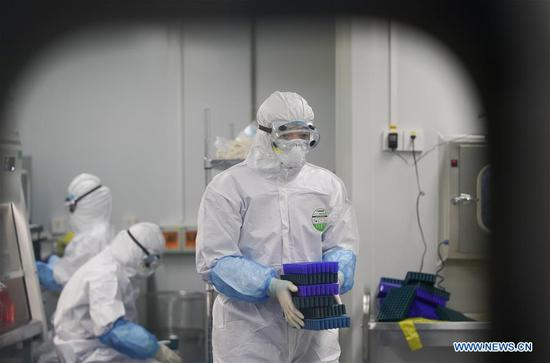Staff members work at novel coronavirus detection lab in Wuhan
