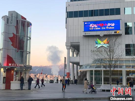 Screen shows 'Go China, Go Wuhan' to express support to China at Canada Place