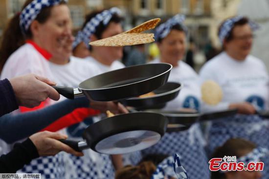 World famous Olney pancake race keeps on running