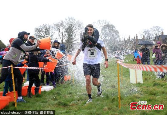 UK wife-carrying contest takes place in Dorking