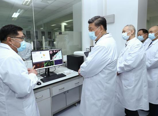 Chinese President Xi Jinping, also general secretary of the Communist Party of China Central Committee and chairman of the Central Military Commission, learns about the progress on the COVID-19 vaccine and anti-body during his visit to the Academy of Military Medical Sciences in Beijing, March 2, 2020. (Xinhua/Ju Peng)