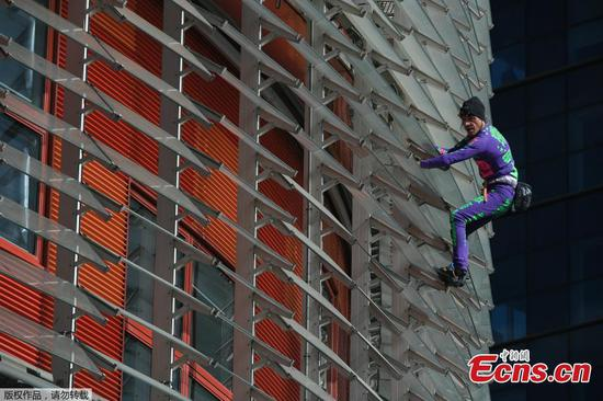 French 'Spiderman' climbs Barcelona skyscraper