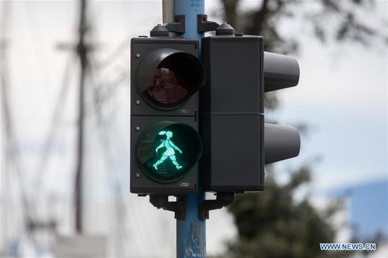 Female traffic light figures seen ahead of International Women's Day