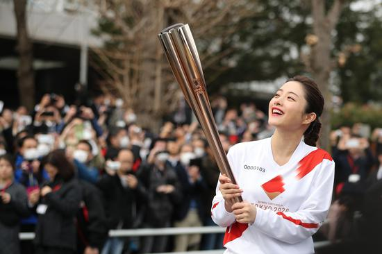 Olympic flame to be carried by car in Japan leg of torch relay