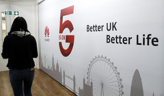 A staff member walks past Huawei 5G Innovation and Experience Center in London, Britain, on Jan. 28, 2020.(Xinhua/Han Yan)