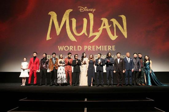 "Photo shows the director and cast of Disney's film ""Mulan"" at the film's world premiere ceremony in Los Angeles, California, the United States, March 9, 2020. (Photo credit: Disney)"