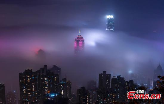 Foggy weather makes Victoria Harbour a fairyland