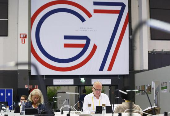 Journalists work at the G7 summit press center in Biarritz, France, Aug. 25, 2019. (Xinhua/Gao Jing)